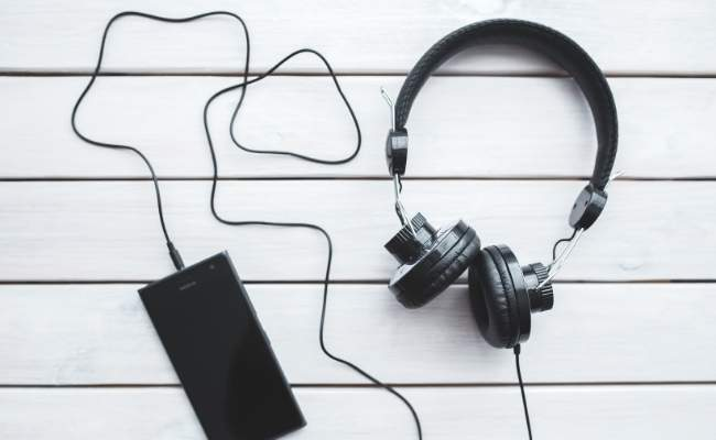 A Picture of Headphone connected to a Mobile Phone - Souce: Unknown